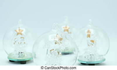 Christmas Trees close up inside glass ball on white background.