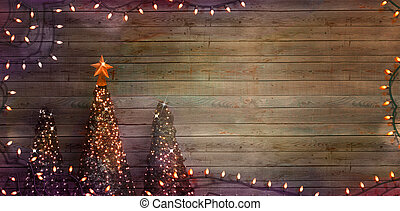 Christmas trees on wood. Fairy Lights