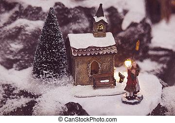 Christmas village house with Christmas tree