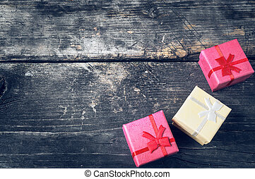 Boxes for gifts on old boards. Christmas background. Christmas decorations. New Year background. Xmax background. Holiday background. Toned image.
