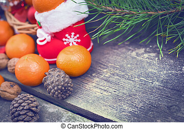 Branches of a Christmas tree on old boards. Christmas background. Christmas Socks. Christmas decorations. New Year background. Xmax background. Toned image.