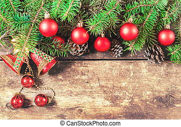 Branches of a Christmas tree on old boards. Christmas background. Christmas decorations. New Year background. Xmax background. Toned image.