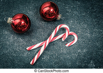 two christmas candys and balls on a dark underground in vintage and grundge style
