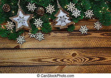 Christmas vintage decoration with fir branch on dark wooden background