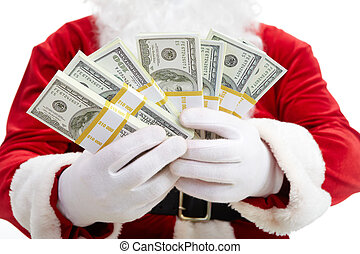 Christmas wealth - Close-up of Santa?s hands with stacks of...