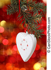 Christmas white heart with against blurred background
