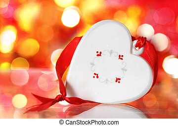 Christmas white heart with red ribbon