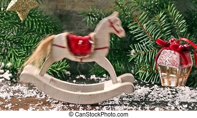Christmas white rocking horse with Christmas tree, toys and...
