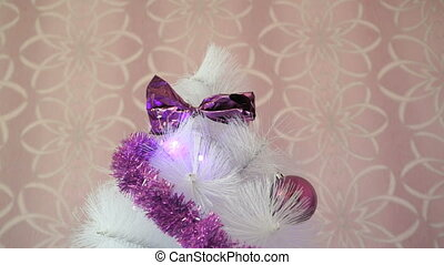 Christmas white tree with purple garland