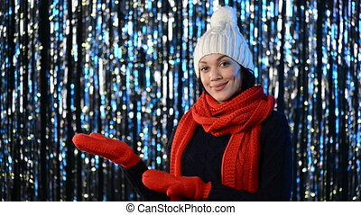 Christmas winter woman showing blank copy space