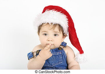 Hmmmm Thinking baby in santa hat with finger to mouth in thinking gesture - landscape.