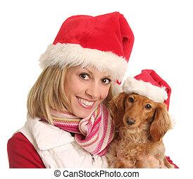 Christmas woman and her dog.