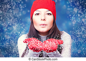 Christmas woman blowing snow