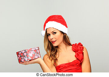 Christmas Woman holding a heart shaped gift box