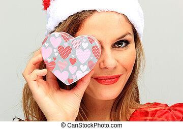 Christmas Woman holding a heart shaped gift box