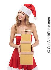 Christmas woman holding gifts wearing Santa costume