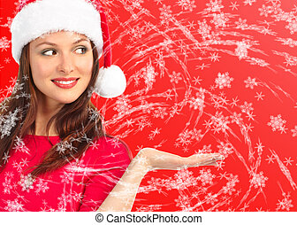 Christmas woman in a Santa Cap. Over red  background