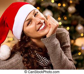 Christmas Woman in Santa Hat. Happy Smiling Girl