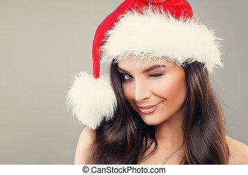 Christmas Woman in Santa Hat Winking. Happy Woman Christmas ...