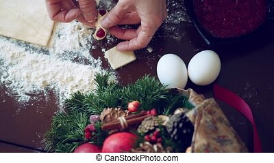 Christmas. woman is preparing sweet little bottles with fruit jam