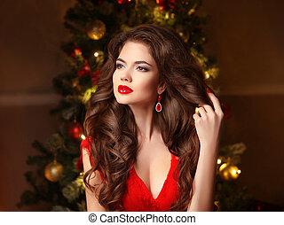 Christmas Woman. Long hair. Fashion earrings. Makeup....
