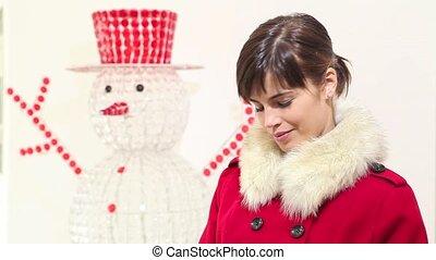 Christmas woman opens bag, surprise