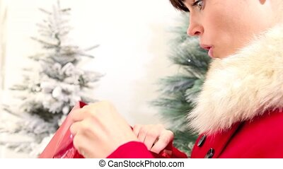 Christmas woman opens bag with gift