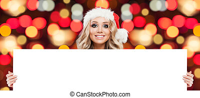 Christmas woman showing white big blank board background with copy space for advertising marketing or product placement on abstract bokeh glitter