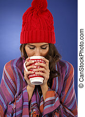 christmas woman with a cup in hand