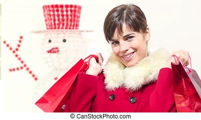 Christmas woman with red bags
