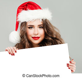 Christmas Woman with White Banner Background. Smiling Brunette Girl in Santa Hat, Winter Woman Christmas Concept