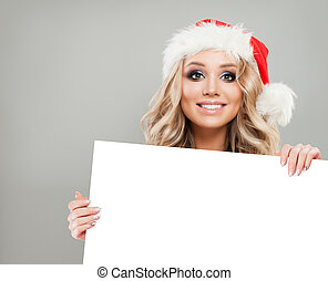 Christmas Woman with White Banner Background. Smiling Girl in Santa Hat, Winter Woman Christmas Concept