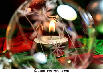 Christmas Wonder - A candle is lit through a crystal ball