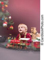 Christmas Wonder - Young boy playing at Christmas tree