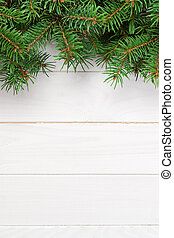Christmas wooden background with fir tree. Top view with copy space for your text
