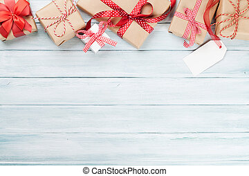 Christmas wooden background with gift boxes