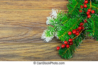 Christmas wooden background with snow fir tree holly berry