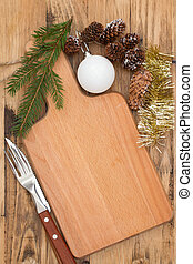 Christmas wooden board with knife on brown wooden background