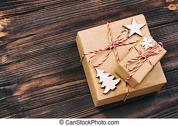 Christmas wooden decorations with snowflakes, white stars and Xmas trees on a background of black vintage old wooden boards. Background for your text and design