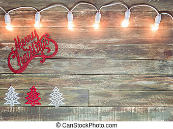 christmas wooden textured background with light garland