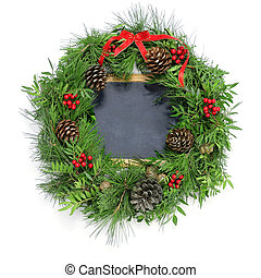 christmas wreath and a blank chalkboard