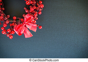 Christmas wreath and bow on a black canvas background