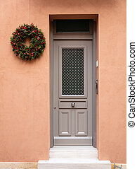 Christmas wreath decoration. Wooden entrance door in old...