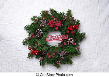 Christmas wreath, isolated on white knitting background,...