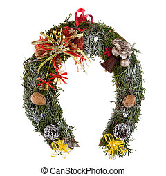 Christmas wreath made of moss in the shape of a horseshoe isolated on white background