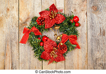 Christmas wreath of fir branches with bows and floral...