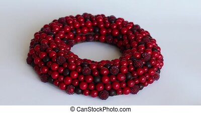 Christmas wreath of red berries on a white isolated background
