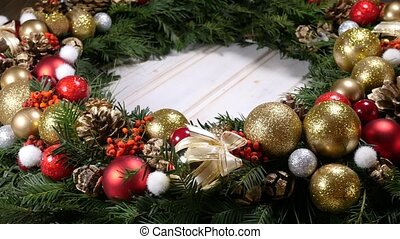 Christmas wreath on a wood background - rotating detail of a...