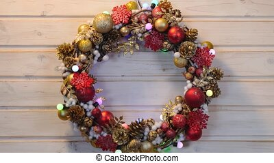 Christmas wreath on a wood background with flashing garland,...