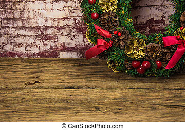 christmas wreath on  brick wall background